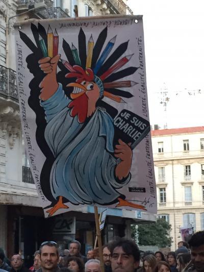 Le coq, emblème de la France et de la liberté d'expression.